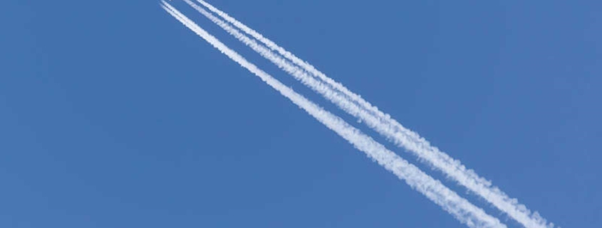 How are contrails left by airplanes generated and affected?